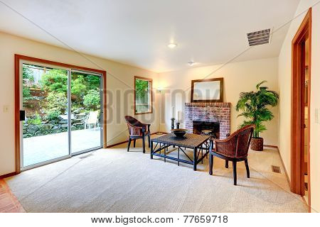 Living Room With Sitting Area By The Fireplace