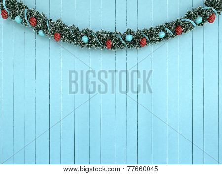 Christmas Garland Decoration On Aqua Wood Background