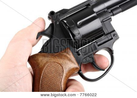 Hand pulling trigger isolated on white