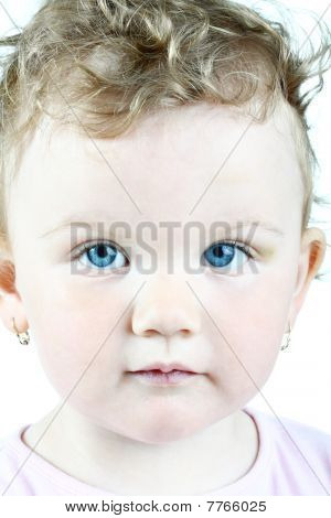 Portrait of a blue-eyed baby girl, high key, isolated on white