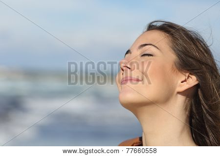 Closeup Of A Woman Breathing Fresh Air On The Beach