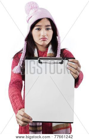 Disappointed Girl Displaying Empty Clipboard