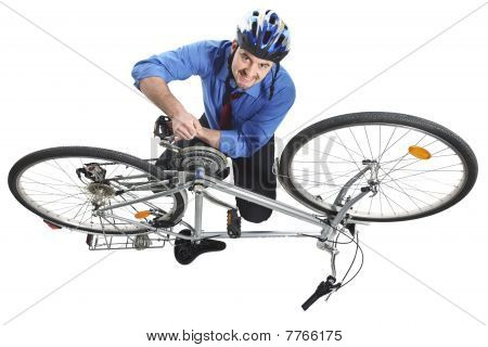 Man Repai His Bicycle