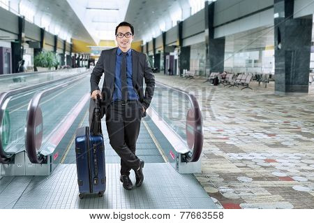 Successful Entrepreneur Standing In Airport Hall