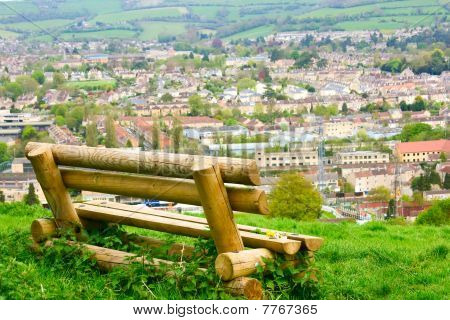 A Rustic Bench Overlooking The City Of Bath