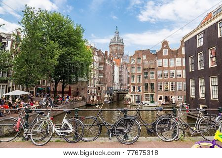 Bicycles On A Bridge Over The Canals Of Amsterdam