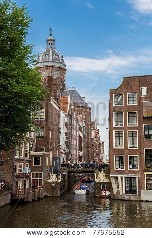 Canal And St. Nicolas Church In Amsterdam