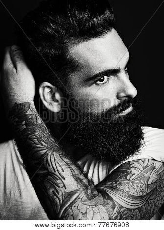 B/w Portrait Of Handsome Bearded Man With Tattoo