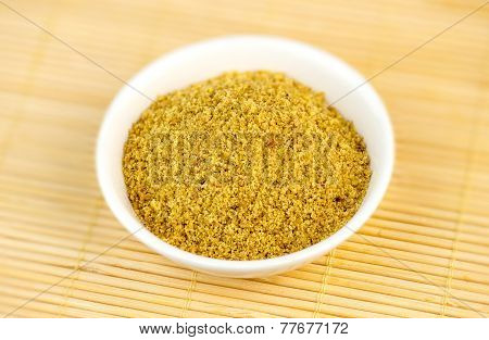 Flaxseed Meal Powder In White Bowl