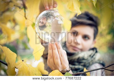 Woman Balancing Crystal Ball