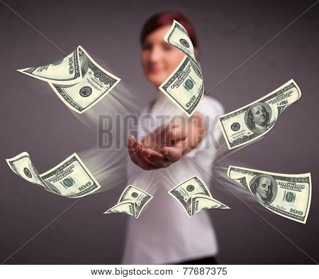 Beautiful young girl throwing money