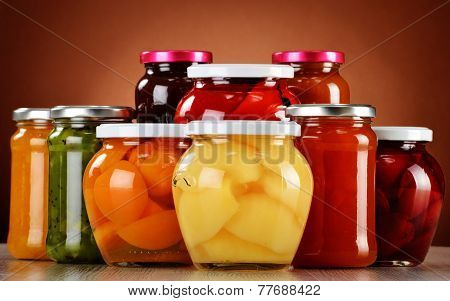 Jars With Fruity Compotes And Jams. Preserved Fruits
