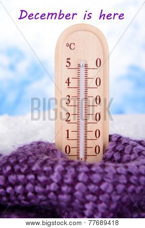 Composition with thermometer in scarf as greeting card