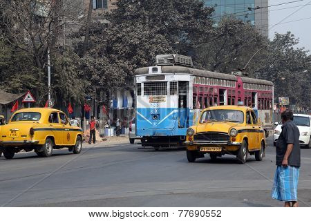 KOLKATA, INDIA - FEB 08: Traditional tram downtown Kolkata on February 08, 2014. Kolkata is the only Indian city with a tram network, which is operated by the Calcutta Tramways Comp.