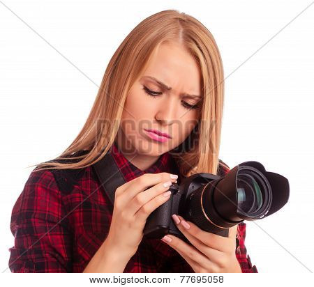 Attractive Female Photographer Studying Her Professional Camera