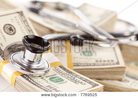 Stethoscope Laying On Stacks Of Money