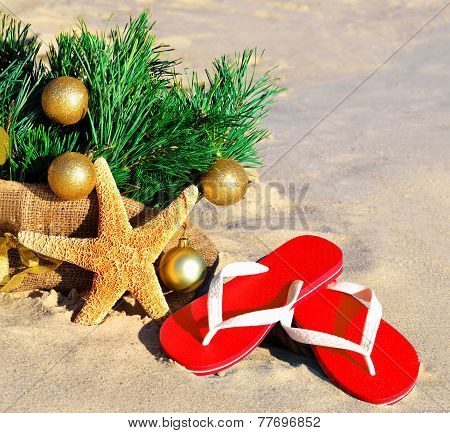 Christmas Tree With Christmas Balls, Slippers And Starfish On The Sand