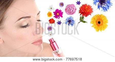 Young woman applying perfume with flower aroma, isolated on white