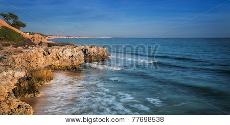 Sea Surf In Albufeira Beach And Mountain In Portugal. Algarve Coast.