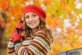 foto of beret  - portrait of beautiful attractive stylish young woman in red beret in autumn park outdoors background - JPG