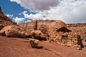 picture of cliffs  - Native American home in Cliff Dwellers located in Northern Arizona at Marble Canyon and at the foot of Vermillion Cliffs is known for its unique shaped boulders and rugged terrain - JPG