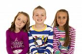 stock photo of pajamas  - Portrait of children wearing colorful winter pajamas - JPG