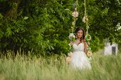 image of swing  - A beautiful bride in a white wedding dress - JPG