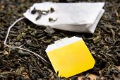 picture of tea bag  - close up picture of tea bag and black tea leaves - JPG