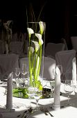 stock photo of calla  - Festive table decoration at a wedding with with callas in a tall - JPG