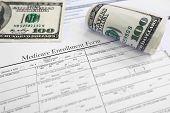 pic of medicare  - A Medicare enrollment form and some cash - JPG