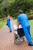foto of hospital patient  - nurse waving goodbye to patient in the park - JPG