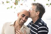 stock photo of gay couple  - Portrait of a happy gay couple in love - JPG