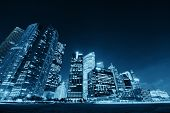 stock photo of singapore night  - Singapore skyline at night with urban buildings - JPG