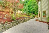 pic of landscape architecture  - Walkout patio with sitting area and backyard leveled landscape design with stones - JPG