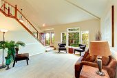 pic of vault  - Bright ivory living room with high vaulted ceiling and french window and staircase - JPG