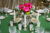 picture of centerpiece  - Ornamental Christmas centerpiece surrounded by elegant china crystal and silverware - JPG