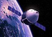 stock photo of orbit  - Crew Exploration Vehicle Orbiting Earth - JPG