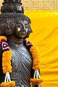stock photo of metal sculpture  - Multi headed metallic buddha on yellow background thailand - JPG