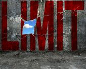 pic of wall cloud  - red LIMIT word on grey grunge concrete wall with nature sky cloud view through big hole - JPG