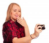picture of humiliation  - Attractive female photographer holding compact camera and humiliating it  - JPG