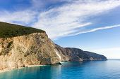 foto of rough-water  - beautiful beach with blue water and big mountain with rough cliffs - JPG