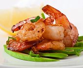 stock photo of sauteed  - Shrimp sauteed with garlic and soy sauce on a cushion of avocado slices - JPG