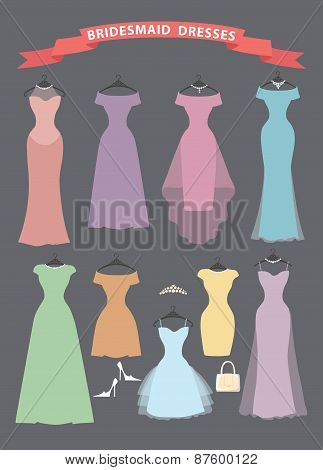 Set of bridesmaid dresses hang on ribbons