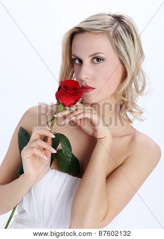 beautiful blond girl with red rose flower on a white background