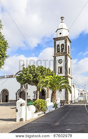 L Church Of San Gines In Arrecife With Its White-washed Exterior And Attractive Bell Tower