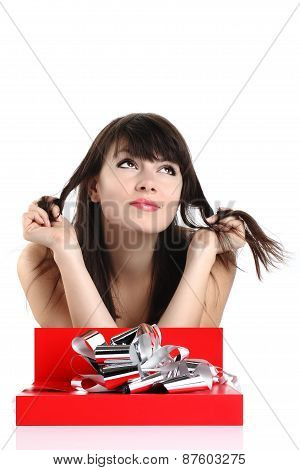 beautiful girl with gift in red box with silver ribbon