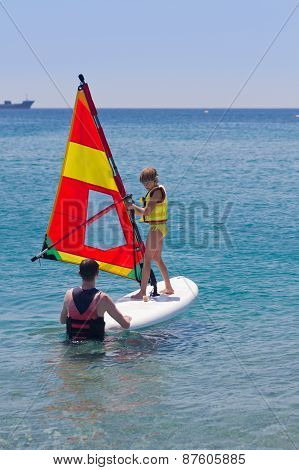 Beginner Windsurfer Girl Taking Lessons