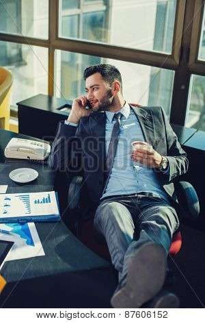 Young Business Man Relaxed At Work