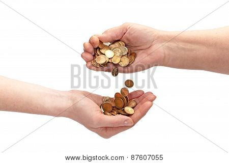 The Hand Of An Elderly Woman Pouring Coins Into The Hand Of A Young Female. Isolated Over White.