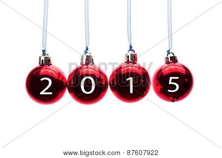 Four red christmas balls with numbers of old year 2015